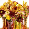 Enkele sfeervolle herfstcreaties vol fleurige chrysanten.
