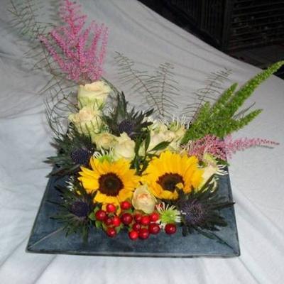 Zonnebloemen en amaranthus