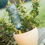 Druppelsysteem voor op flessen